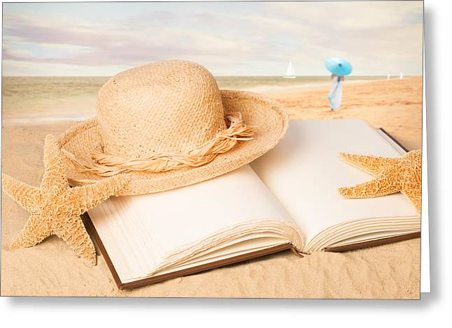Straw Hat On Beach With Book Greeting Card by Amanda Elwell