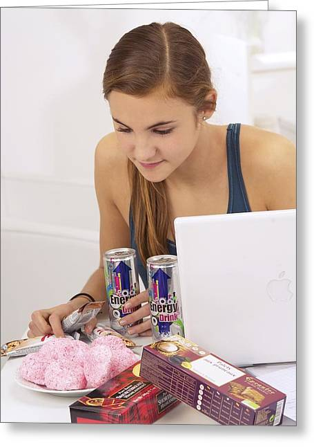 Student Eating Sugary Snacks Greeting Card by Science Photo Library