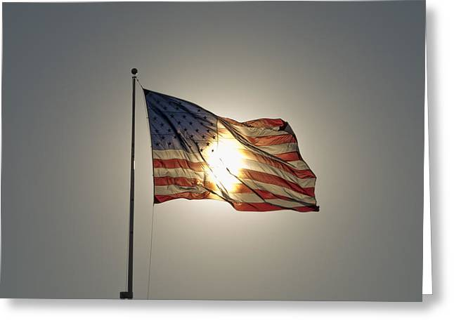 Sun Behind Stars And Stripes Greeting Card by Chris Cameron
