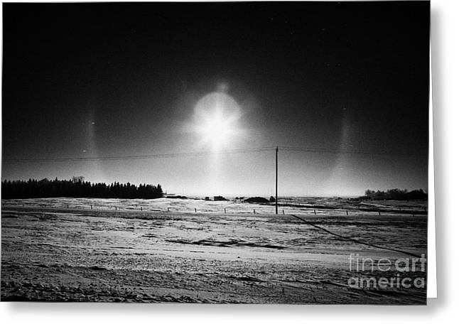 sun dog parhelion halo due to ice crystals surrounding the sun in Saskatchewan Canada Greeting Card