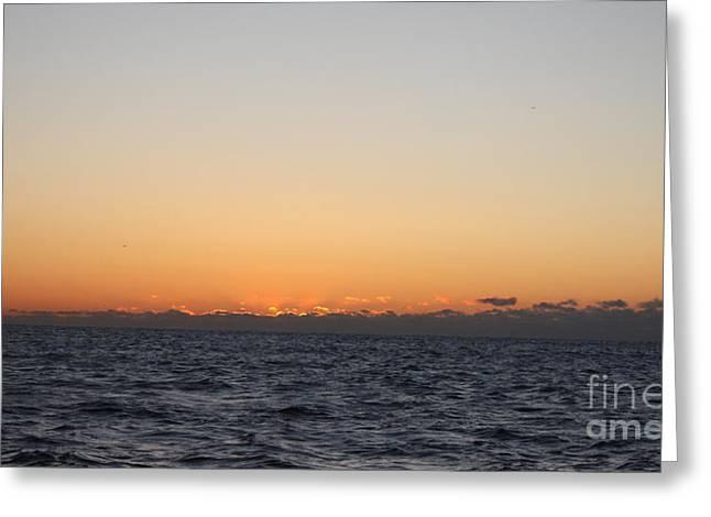 Sun Rising Above Clouds And Horizon Greeting Card by John Telfer
