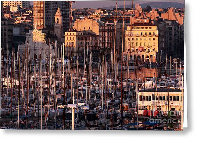 Sun Sets On The Port Greeting Card by John Rizzuto