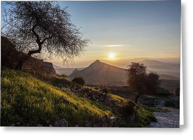 Sun Setting Over The Peaks Of Mountains Greeting Card by Reynold Mainse