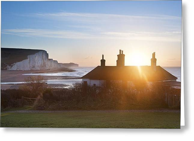 Sunrise Over Coastguard Cottages At Seaford Head With Seven Sist Greeting Card by Matthew Gibson