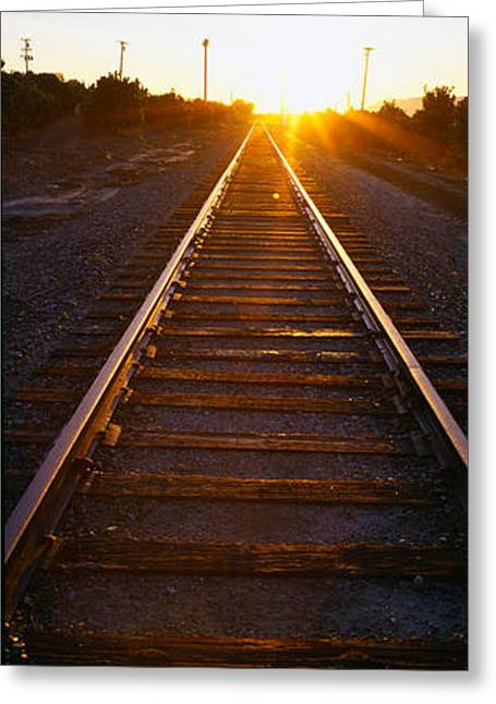 Sunrise Over Railroad Tracks Greeting Card by Panoramic Images
