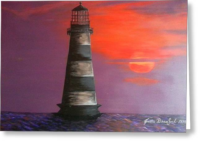 Sunset And Lighthouse Greeting Card by Joetta Beauford