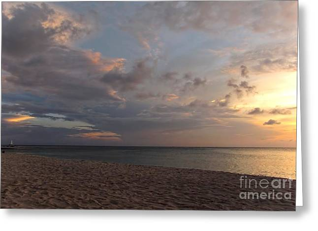 Sunset Grand Cayman Greeting Card by Peggy Hughes