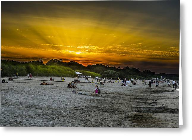 Sunset On The Crowded Beach Greeting Card by Adam Budziarek