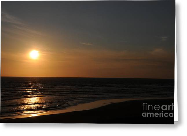 Sunset Over Calm Waters Greeting Card