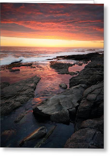 Sunset Over Rocky Coastline Greeting Card