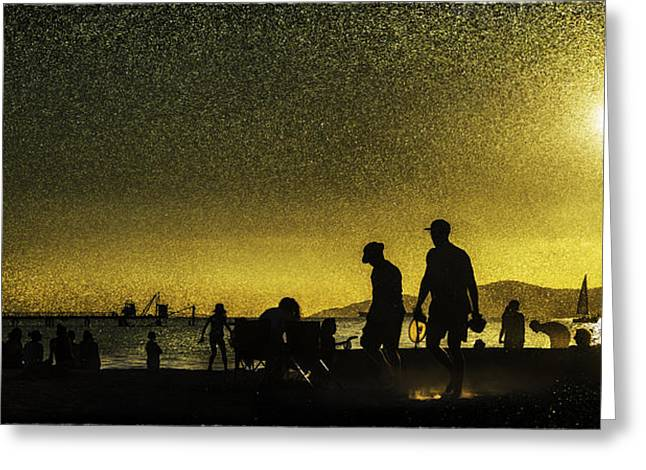 Greeting Card featuring the photograph Sunset Silhouette Of People At The Beach by Peter v Quenter