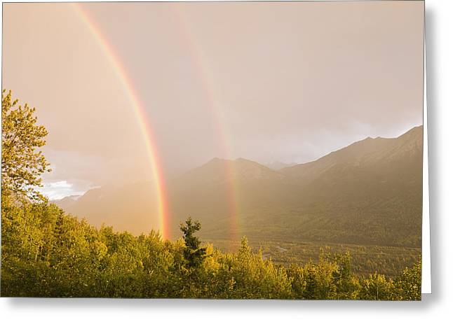Sunset View Of A Double Rainbow Arching Greeting Card by Ray Bulson