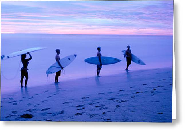 Surfers On Beach Costa Rica Greeting Card by Panoramic Images