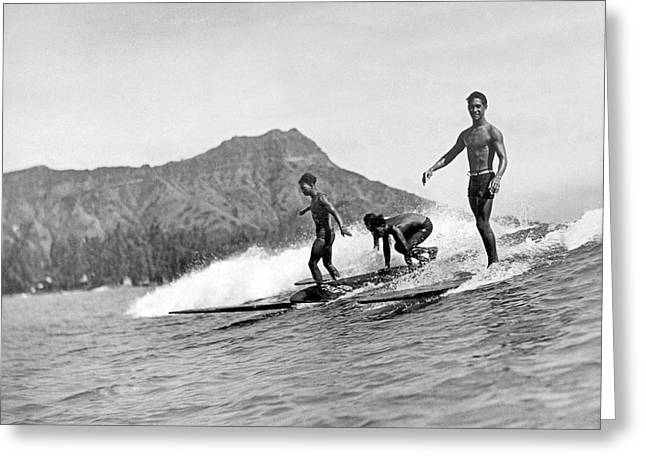Surfing In Honolulu Greeting Card by Underwood Archives