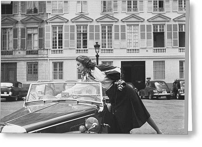 Suzy Parker Outside The French Vogue Office Greeting Card by Jacques Boucher
