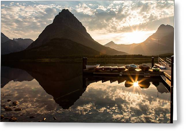 Swiftcurrent Lake Boats Reflection And Flare Greeting Card