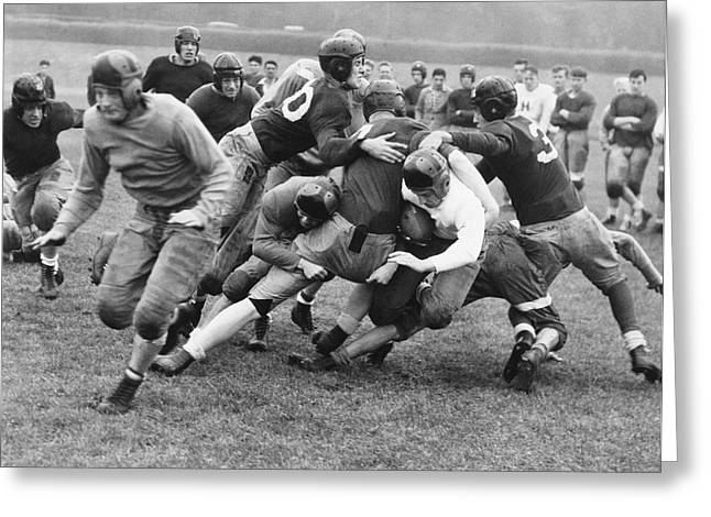 Tackled In The Football Line Greeting Card by Underwood Archives