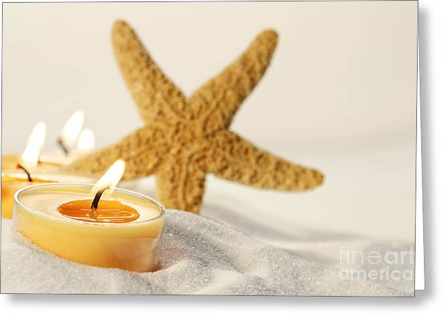 Greeting Card featuring the photograph Tea Light Candles In Sand With Star Fish by Sandra Cunningham