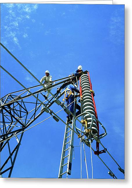 Technicians Servicing A Power Line In Training Greeting Card