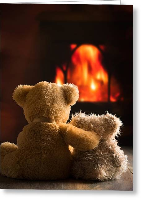 Teddies By The Fire Greeting Card by Amanda Elwell