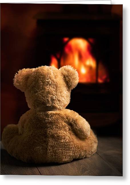 Teddy By The Fire Greeting Card by Amanda Elwell