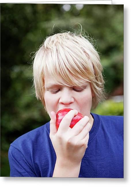 Teenage Boy Eating An Apple Greeting Card by Thomas Fredberg