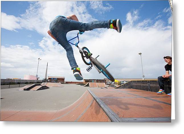 Teenage Boys Perform Aerial Stunts Greeting Card by Ashley Cooper
