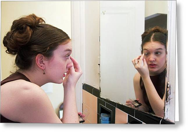 Teenage Girl Applying Make-up Greeting Card