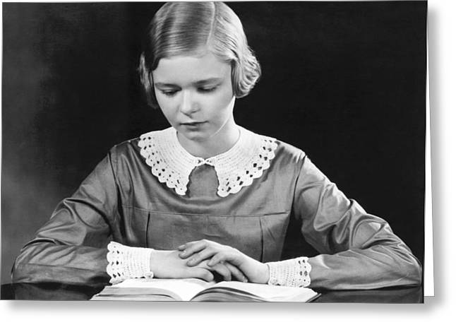 Teenage Girl Reading A Book Greeting Card by Underwood Archives