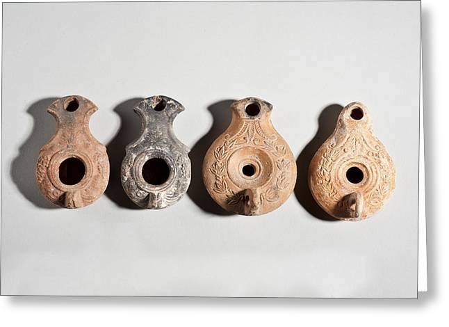 Terracotta Oil Lamps Greeting Card by Science Photo Library