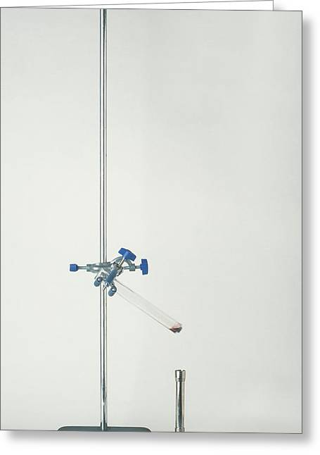 Test Tube Angled In A Clamp Stand Greeting Card by Dorling Kindersley/uig