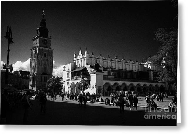 The 16th Century Cloth Hall Sukiennice Building And 13th Century  Gothic Town Hall Tower With Tourists In Rynek Glowny Town Square Krakow Greeting Card