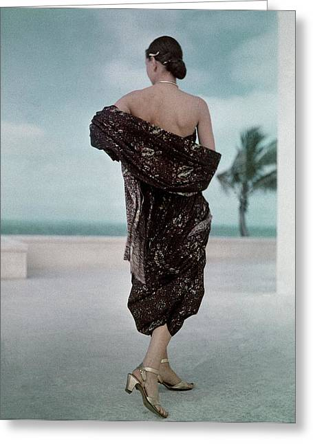 The Back Of A Woman Wearing A Brown Dress Greeting Card by John Rawlings