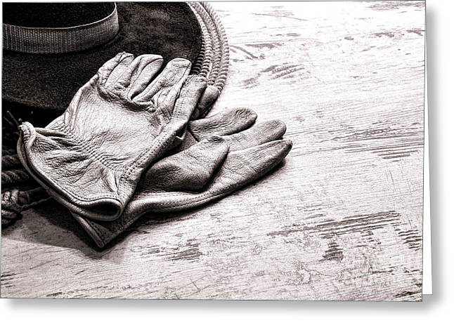 The Cowboy Gloves Greeting Card by Olivier Le Queinec