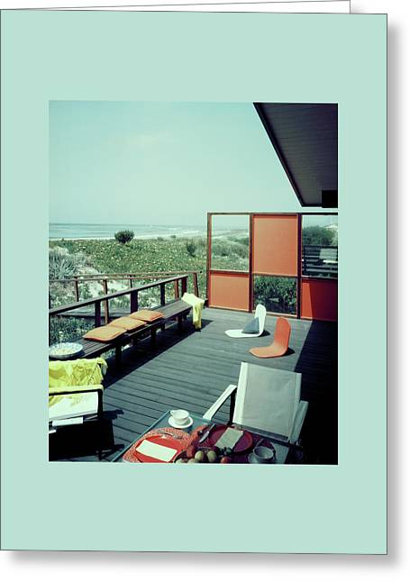 The Deck Of A Beach House Greeting Card by George De Gennaro