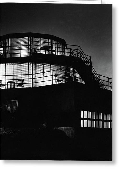 The Exterior Of A Spiral House Design At Night Greeting Card