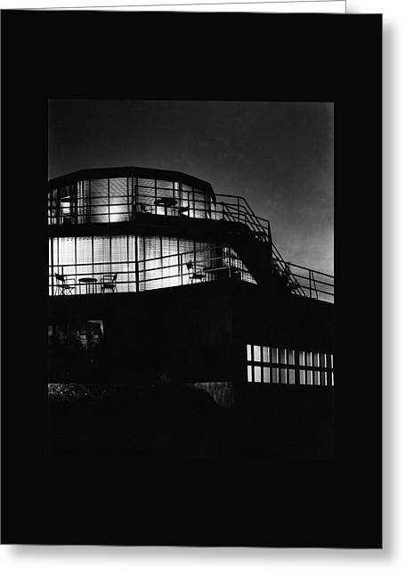 The Exterior Of A Spiral House Design At Night Greeting Card by Eugene Hutchinson