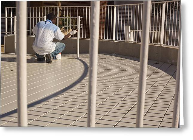 black man painting white fence - The Fine Line Greeting Card by Kobi Amiel