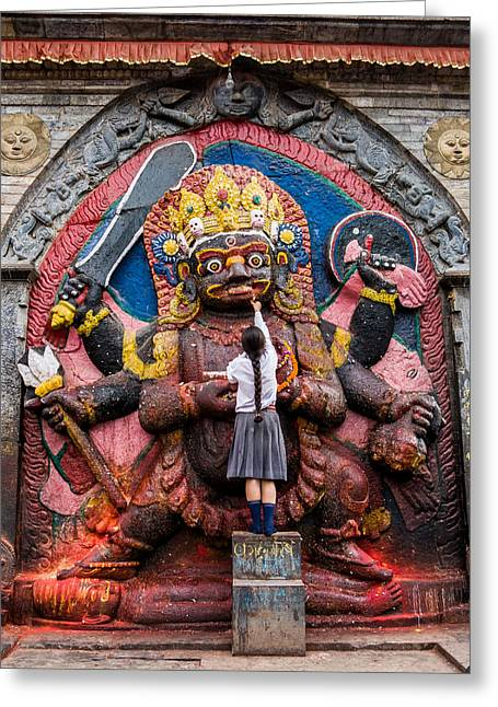 A Nepali School Girl Offers A Butter Lamp To The Fearsome Kala Bhairava Greeting Card