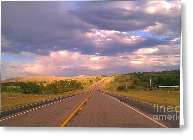 Greeting Card featuring the photograph The Long Road Home by Chris Tarpening