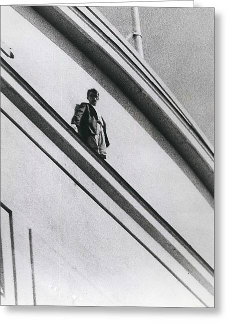 The Man In Love Is Saved From A Parapet Greeting Card by Retro Images Archive