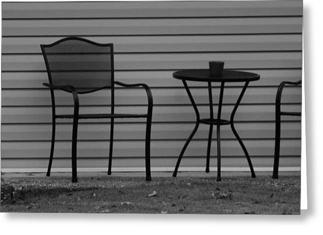 The Patio Chairs In Black And White Greeting Card by Rob Hans