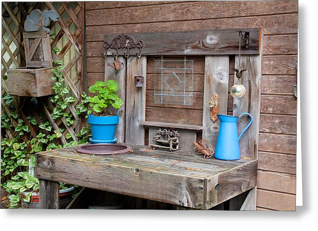 The Potting Bench Greeting Card by Geraldine Alexander
