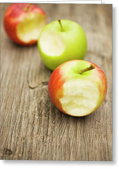 Three Apples With Bites Taken On Wooden Background Greeting Card