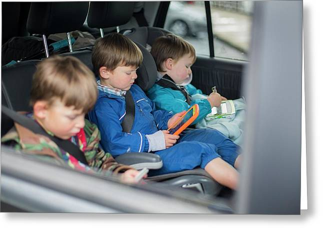 Three Brothers In Car With Digital Device Greeting Card by Samuel Ashfield