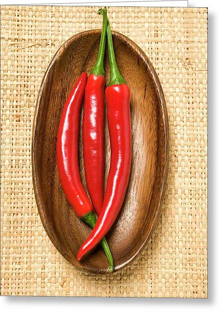 Three Chili Peppers In Wooden Bowl Greeting Card