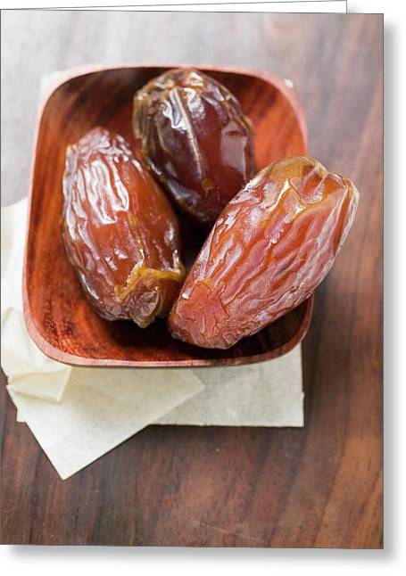 Three Dried Dates In Wooden Bowl Greeting Card