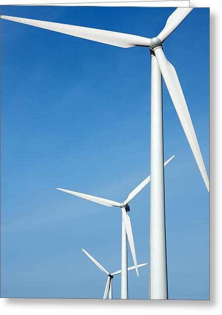 Three Mighty Windmills In A Row Against A Blue Sky. Greeting Card