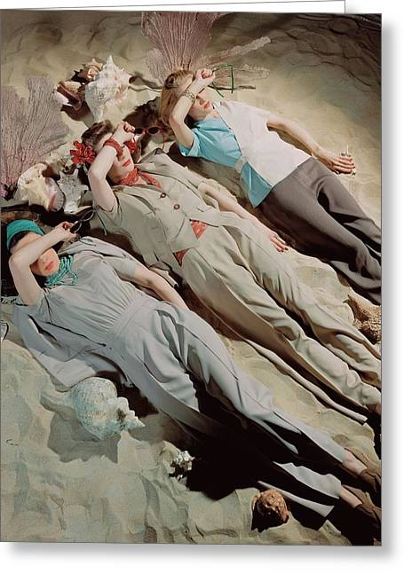 Three Models Lying Down On Sand Greeting Card by John Rawlings