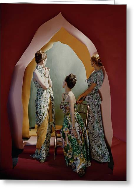 Three Models Wearing Patterned Dresses Greeting Card by Cecil Beaton